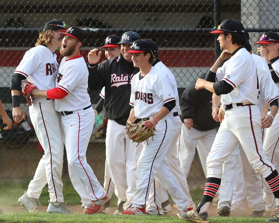 Patchogue-Medford celebrates after the final out of their