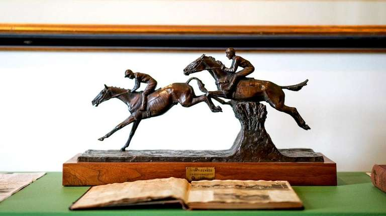 This bronze steeplechase statue is part of the