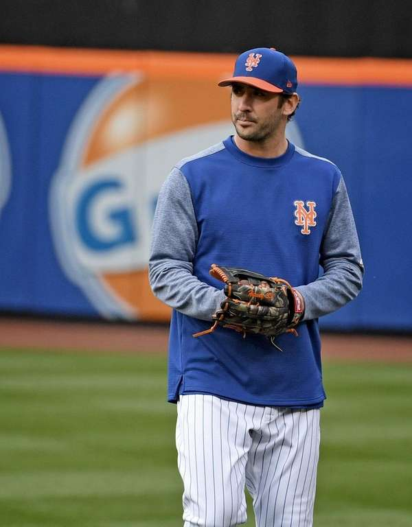 New York Mets' Matt Harvey walks off the