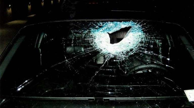 The shattered window of a BMW that was