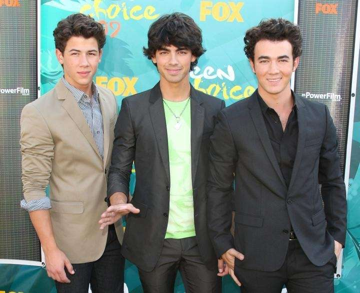 Singers Nick Jonas, left, Joe Jonas, center, and