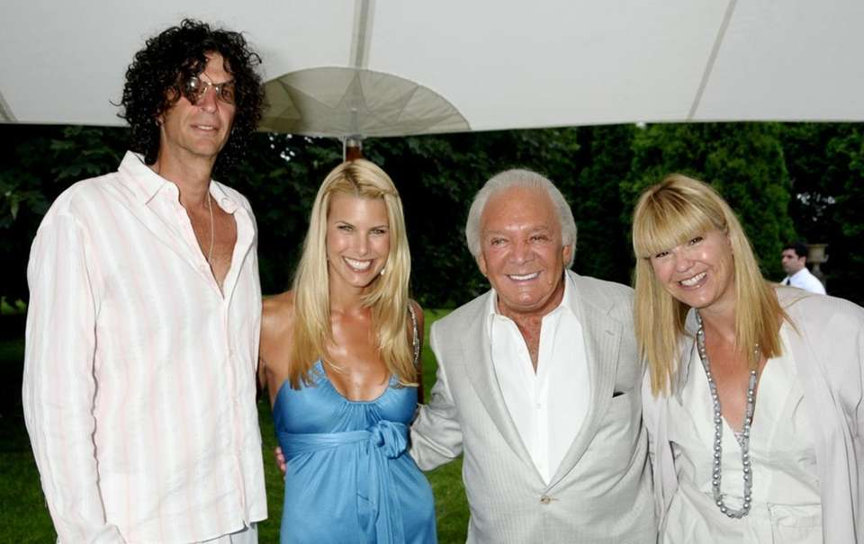 August 8:Southampton(l-r) Howard Stern, Beth Ostrosky, Marty Richards,and