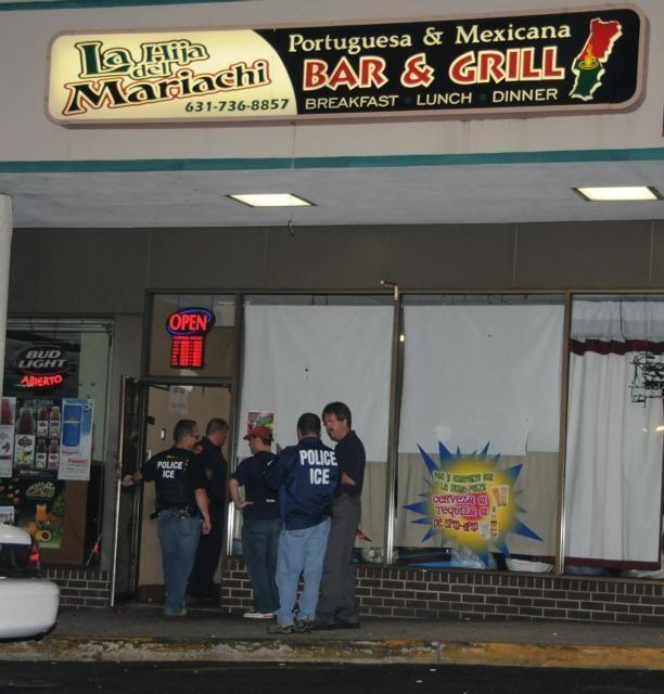 Police enter the LaHija Del Mariachi Bar &
