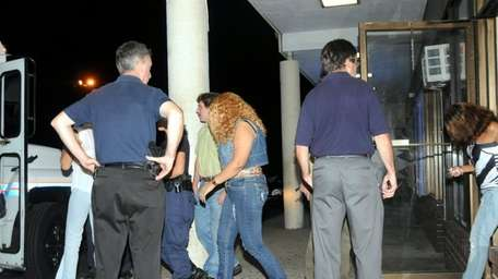 Seven alleged sex trafficking victims are escorted into