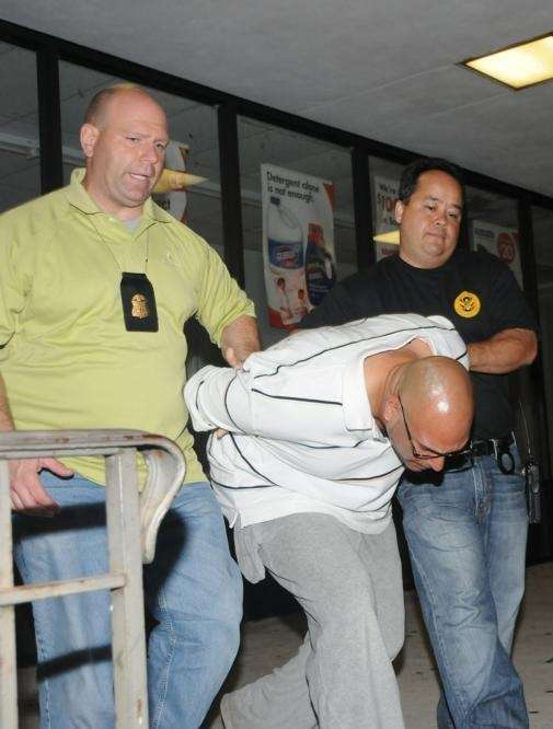 Police arrest a man at the LaHija Del