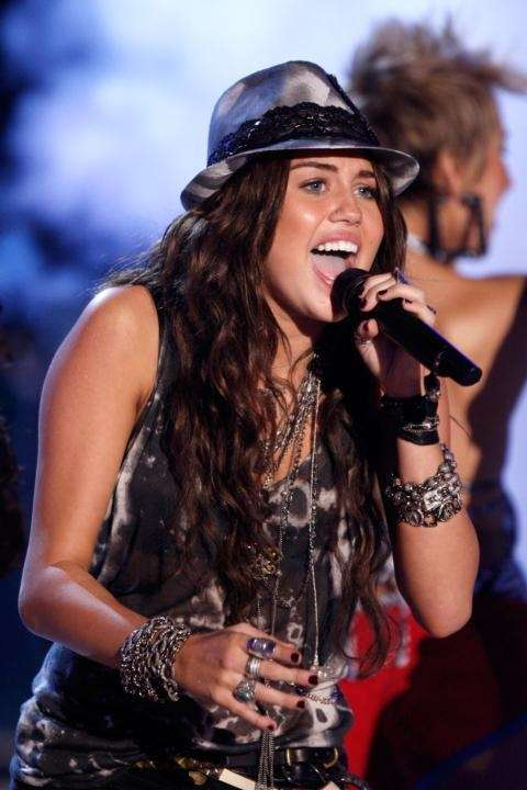 Singer Miley Cyrus performs onstage during the 2009