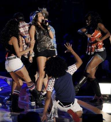 Miley Cyrus, center, performs at the Teen Choice