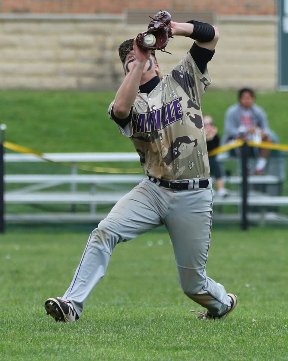 Sayville's Jake Sheridan makes a running catch against