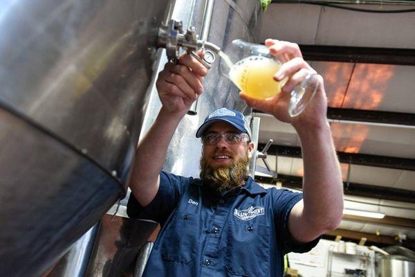 Head Brewmaster Dan Jansen, pours a tulip glass