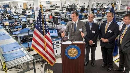 Rep. Thomas Suozzi, left, talking with Hitemco customer