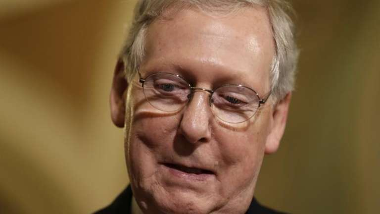 Senate Majority Leader Mitch McConnell of Ky. pauses