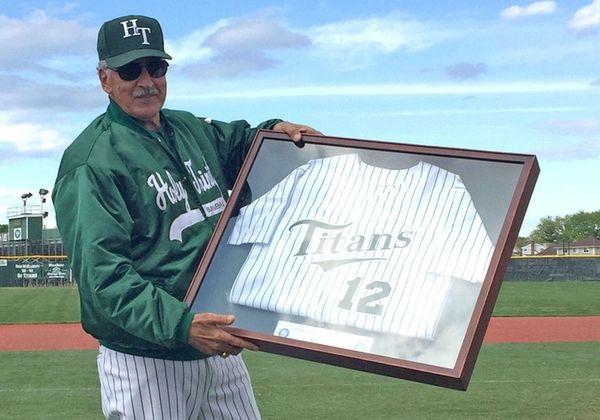 Bob Malandro, Holy Trinity's retiring baseball coach, poses