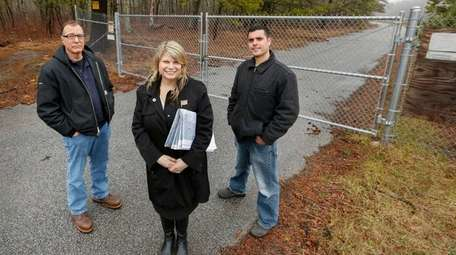 Riverhead Town engineer Drew Dillingham, left, Councilwoman Jodi