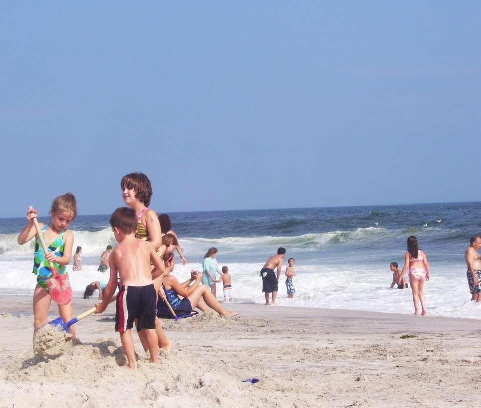 Kids dig in the sand at Robert Moses