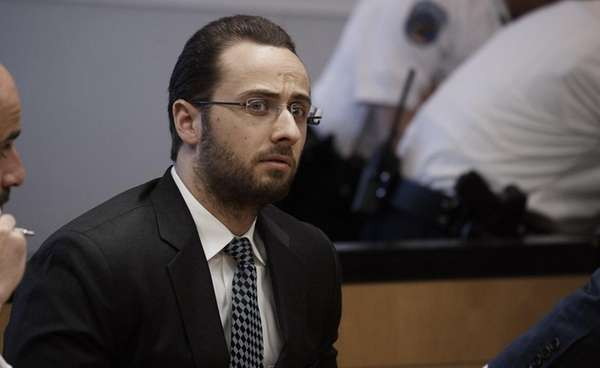 Daniel Greenspan listens as he is sentenced for
