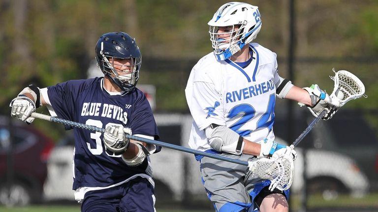 Huntington's Ryan Stieve (36) plays tight defense on