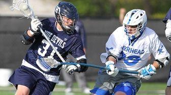 Huntington's Matt Gelb (31) goes to the net
