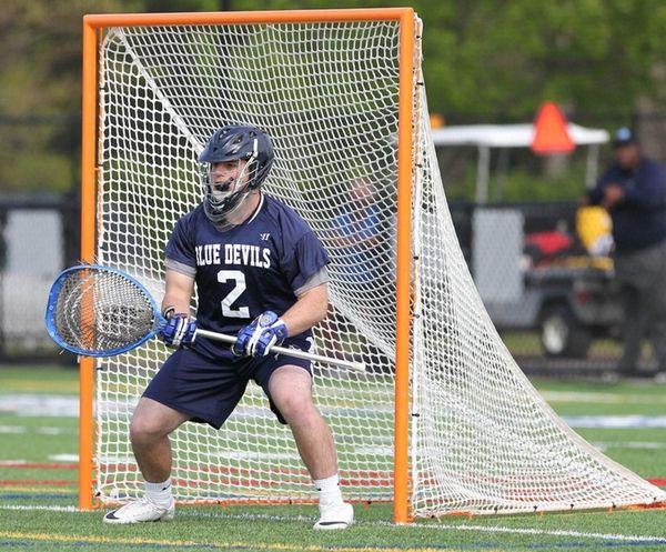 Huntington's Sam Bergman follows the play in win