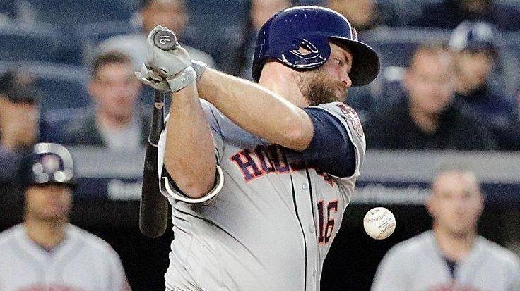 Astros catcher Brian McCann fouls the ball