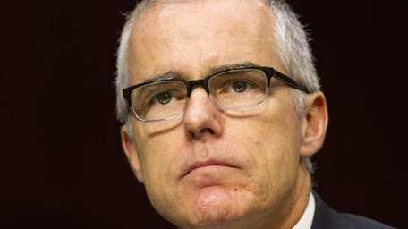 Acting FBI Director Andrew McCabe listens on Capitol