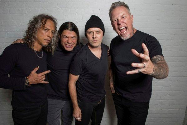 Metallica -- Kirk Hammett, left, Robert Trujillo, Lars