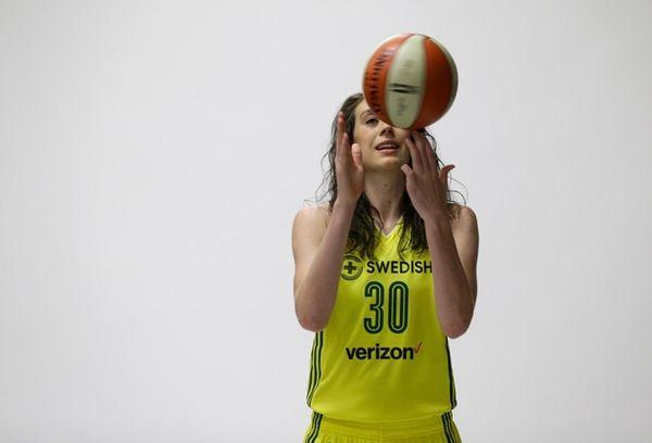 Seattle Storm forward Breanna Stewart spins a basketball