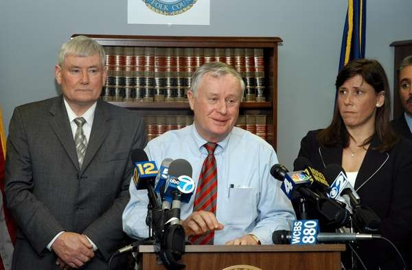 Suffolk County District Attorney Thomas Spota, flanked by