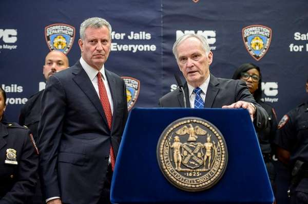 New York City Correction Commissioner Joseph Ponte, right,