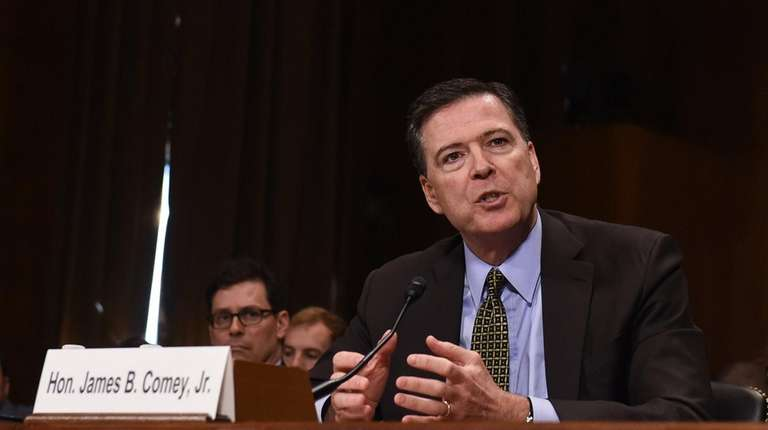 Former FBI Director James Comey testifies before the