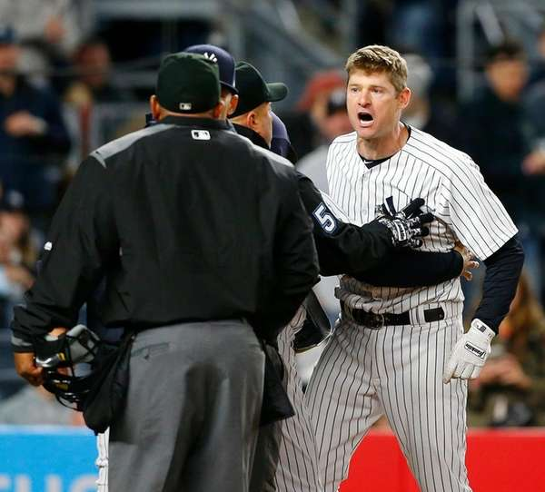 Chase Headleyof the New York Yankees argues with
