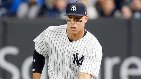 Aaron Judge of the New York Yankees fields