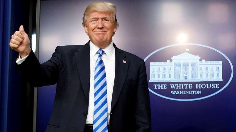 President Donald Trump gives a thumbs-up as he