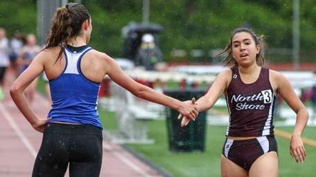 3000-meter run winner Klaire Klemens congratulates second-place finisher