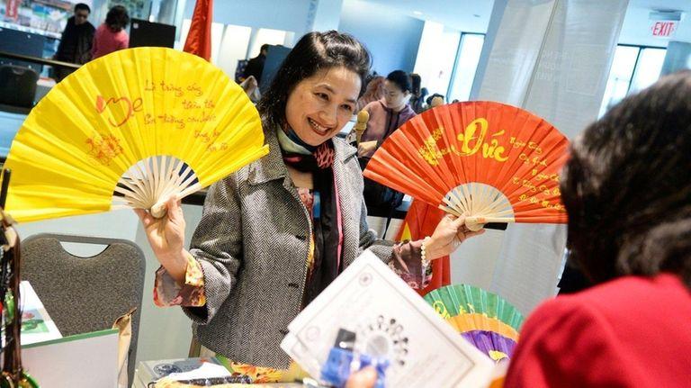 Giang Pham of Vietnam displays traditional Vietnamese fans