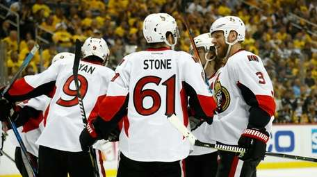 Mark Stone #61 of the Ottawa Senators talks