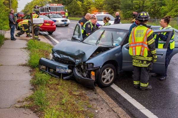 Three people were injured after two cars collided