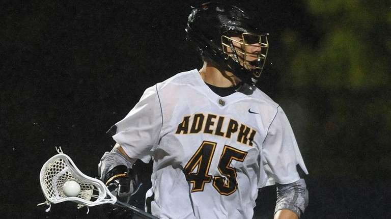 Nick Reisig of Adelphi carries downfield during a