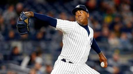 Yankees closer Aroldis Chapman pitches in the ninth
