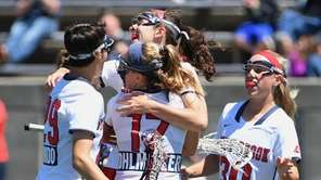 Stony Brook players including attacker Kylie Ohlmiller celebrate