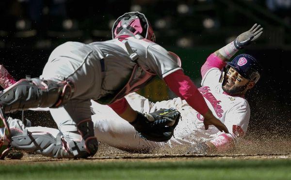 Milwaukee Brewers' Jonathan Villar slides safely home under