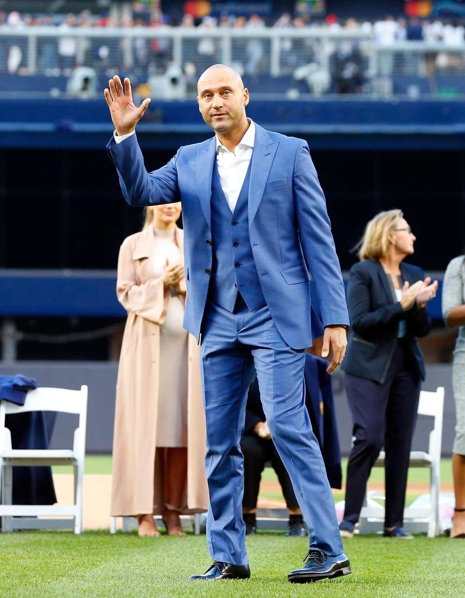 Derek Jeter greets the crowd after speaking during