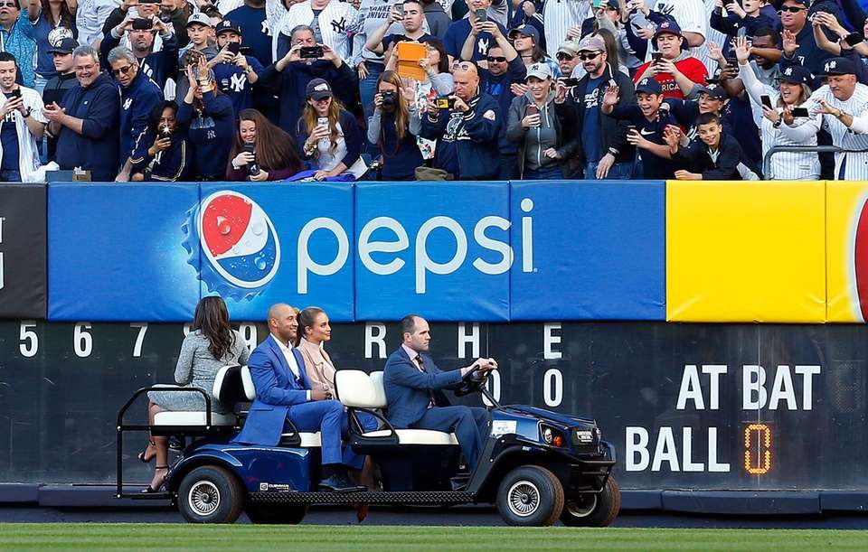 Derek Jeter and wife Hannah are driven to