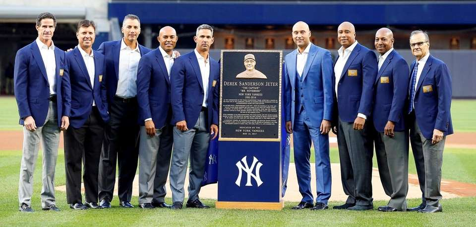 Derek Jeter poses for a photograph with his