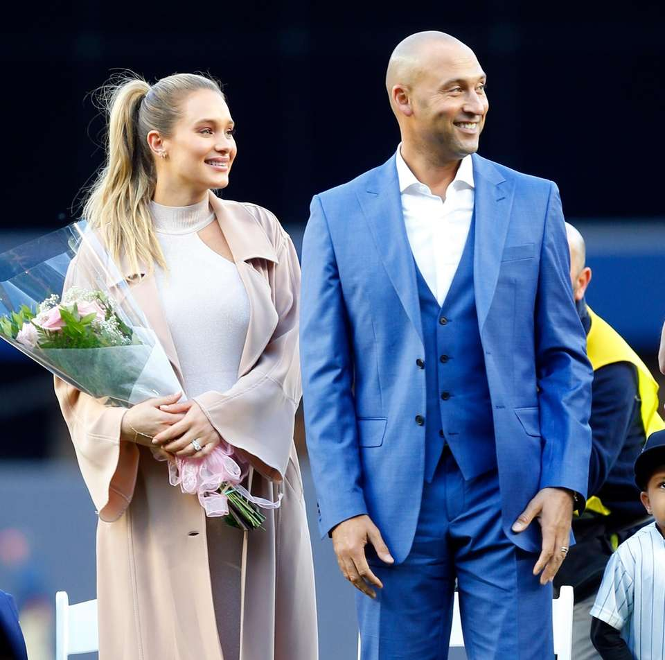 Derek Jeter and wife Hannah look on during
