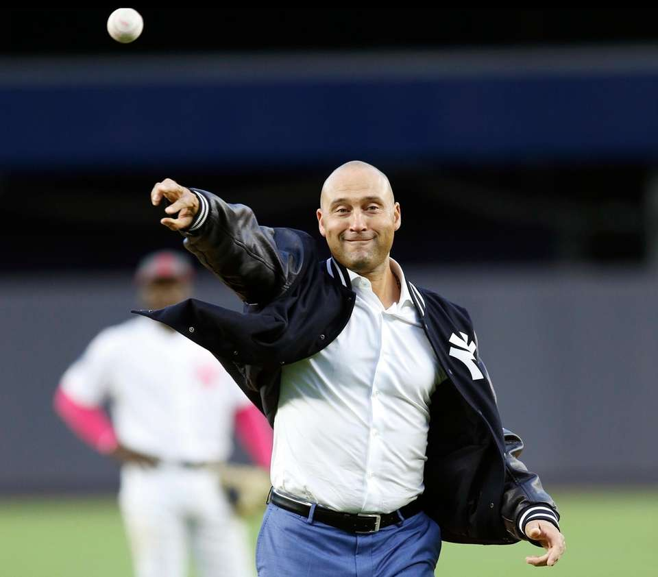 Retired New York Yankees shortstop Derek Jeter throws