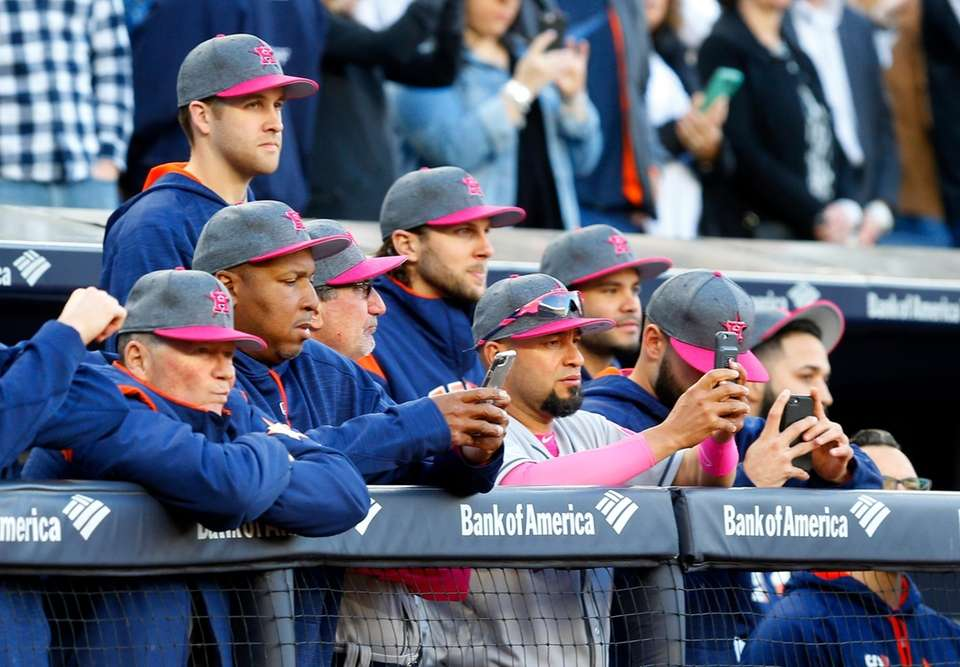 Members of the Houston Astros look on during