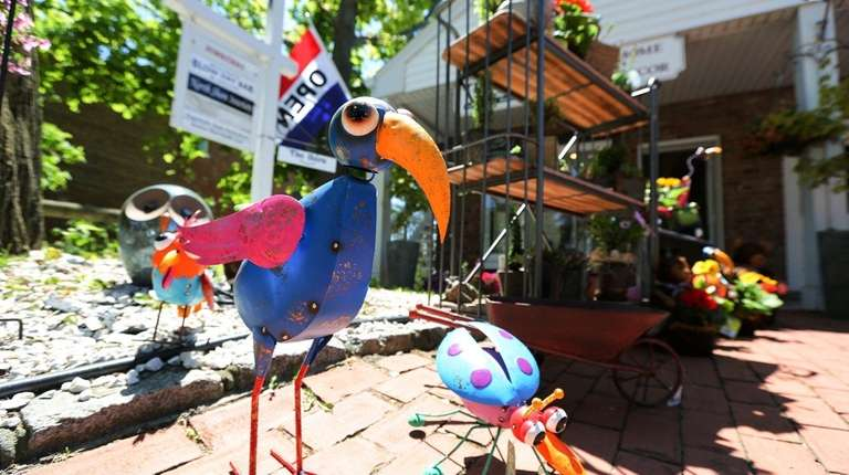 Lawn decorations greet shoppers outside The Barn Downtown,
