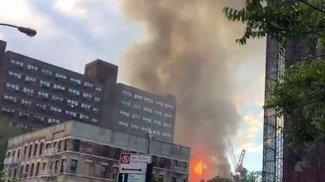 Flames from a fire that the FDNY said
