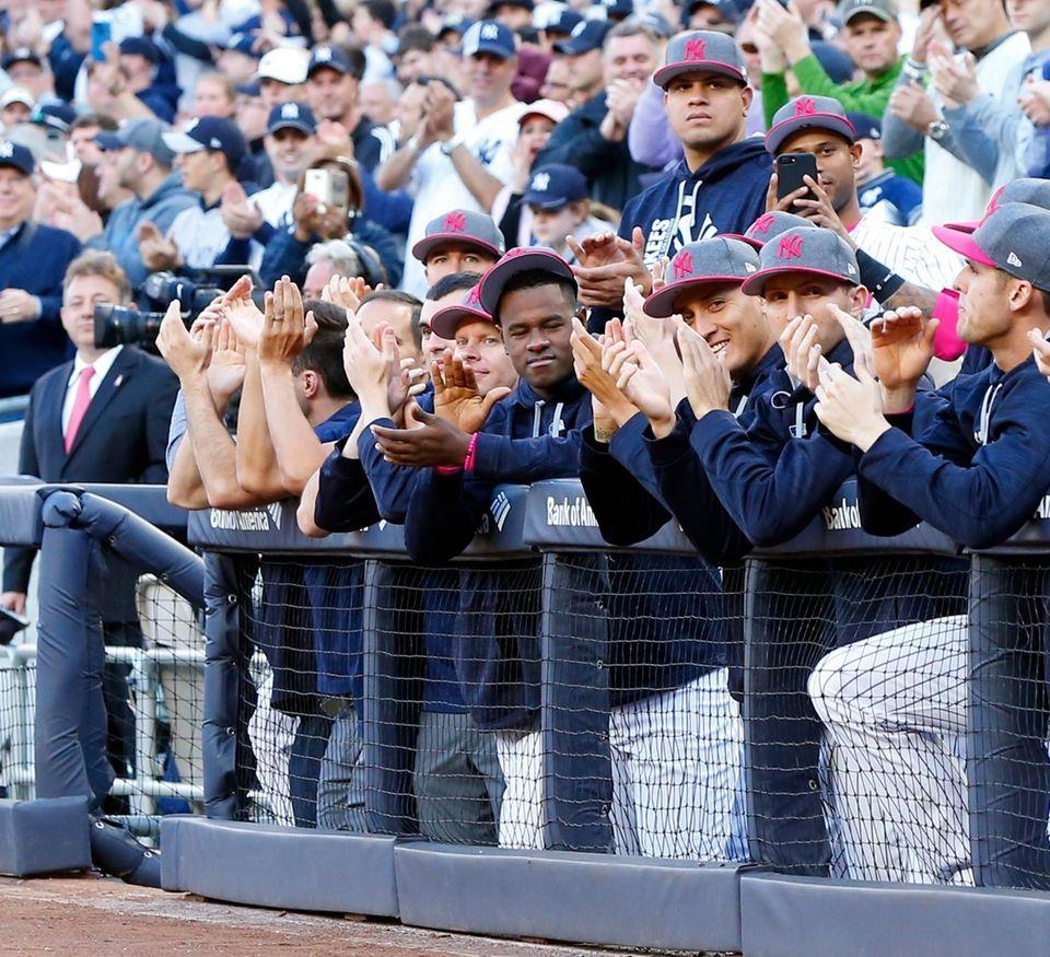 Members of the New York Yankees look on