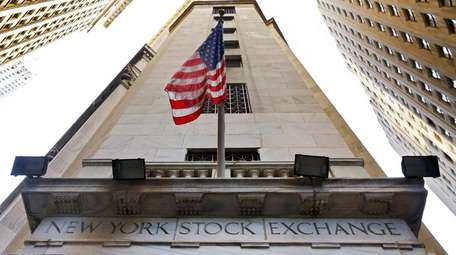 An American flag flies above the Wall Street